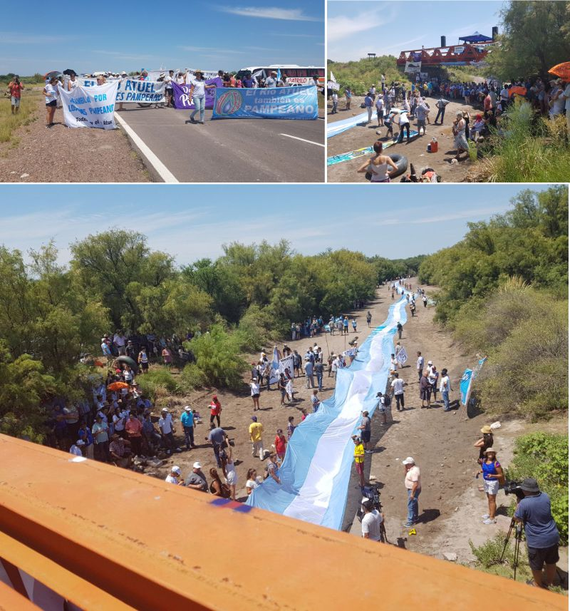 multimedia.normal.9ce552109fe79d96.617475656c6c62616e645f6e6f726d616c2e6a7067 - Manifestación: bandera argentina en el sediento callejón de arena que es hoy el atuel pampeano
